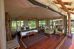 Exploreans Mara Rianta Camp, Mara North Conservancy, Kenya. $960/night.  All 20 luxury tents are built on elevated wooden platforms and have their own private viewing deck from where hippo are regularly seen! Each room has a King size or twin bed with comfortable mattresses and fine linens, the en-suite facilities with solar-heated hot and cold running water consist of a large shower, two hand wash basins, private WC with bidet shower and a Jacuzzi bathtub at some selected tents.