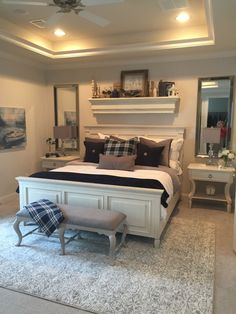 Coastal farmhouse glam master bedroom. This was a fun project infusing colors of navy, cream and grays. #coastalbedroomscolors