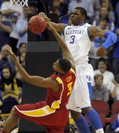 Kentucky forward Terrence Jones (3) blocks the shot of Iowa State forward Melvin Ejim, left, in the first half of their NCAA third-round tournament college basketball game in Louisville, Ky., Saturday, March 17, 2012. (AP Photo/Dave Martin)