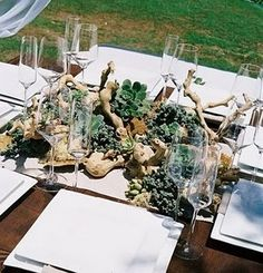 Place branches on table add succulents, air plants and flowers