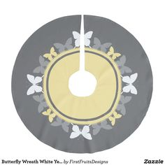 Butterfly Wreath White Yellow Gray Brushed Polyester Tree Skirt Check out this intricate, fresh spring design: a sweet wreath of yellow and white butterflies. It's sharp, and playful, contrasting crisply against a soft gray background.