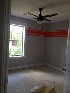 Grey walls orange stripes. Little boys room of new house. Before carpet was installed. Used Frog tape. It worked amazing!