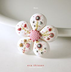 Bloom hand made polymer clay brooch in white.
