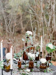 Mixed amber bottles and lush greenery centerpiece inspo Winter Woods Vow Renewal :: Amber+Josh Beer Bottle Centerpieces, Wedding Table Centerpieces, Wedding Flower Arrangements, Floral Centerpieces, Wedding Decorations, Graduation Centerpiece, Quinceanera Centerpieces, Candle Centerpieces, Floral Wedding