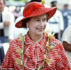 The Queen wears a handcrafted traditional design around her neck while in Kiribati.