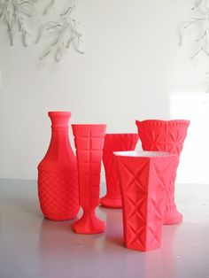 matte bright flourescent pinkish/coral-y/red vases