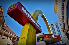 With a design to replicate an old McDonald's arch, it fits oddly in between modern buildings and the Flamingo Casino ... Please feel free to share my photography.    Sun Stroke Photography