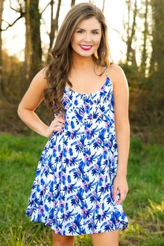 "When you are ""Under The Sun"", there's little that can keep you from shining bright!! With this sun dress ready for when Spring arrives, there is no chance that you will be ""Under"" the weather or under the influence of bad style when it comes to looking Springtime fresh!! Floral dress features spaghetti straps leading to a racerback and a scoop neckline. Model is wearing a small.  • 100% Rayon  • Hand Wash Cold • Fully Lined"