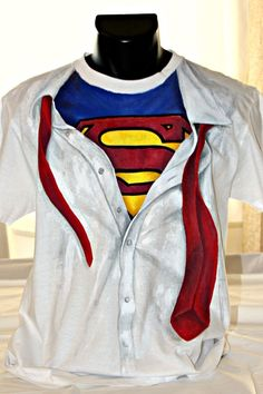 Are you the superhero next door? This is the right shirt for you! Hand-painted man's t-shirt, featuring Superman's suit under his high-collar shirt. The colors are non-toxic, water based, permanent fabric colors. High Collar Shirts, Superman T Shirt, Kids Hands, Boys Shirts, Hand Painted, Superhero, My Style, Fabric, Colors