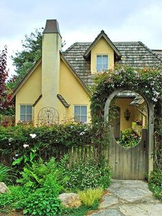 The peek-a-boo garden door invites you in and serves as a trellis