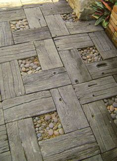 Reclaimed old timber and rock garden path. Love the rustic look. http://thegardeningcook.com/best-home-decor-ideas/page-2/