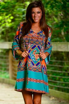 This shift dress is so colorful and we love it! The loose fit with the amazing pattern is so unique! This dress will go with any shoes you pair it with and look amazing!