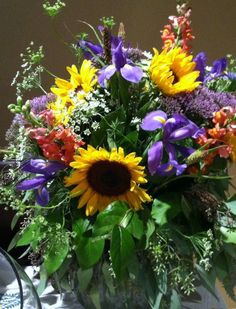 casual summer floral arrangement with sunflowers....making an arrangement for momma and daddy's stones..def love the sunflowers but would add pink in somewhere