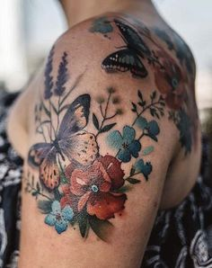 Aga Yadou flower and butterfly tattoo