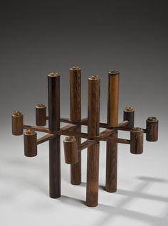 Laur Jensen; Rosewood and Brass Candle Holder, 1959.