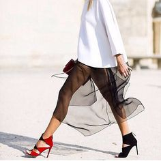 Spring Summer street style, just look at that skirt it's incredible. And those shoes are so cool, do you think she had to buy two separate pairs?