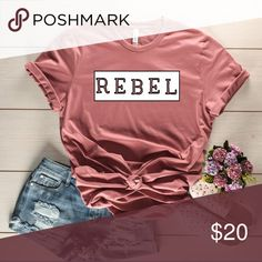 REBEL GRAPHIC TEE (Mauve) Rebel Graphic T shirt Color of shirt: Mauve SHIRT IS NOT UNISEX, Sizing is for women. This shirt provides a longer length.  Ring spun cotton feels soft and smooth due to its refined production process. Its construction creates a stronger, tighter fabric weave that still feels lightweight and breathable. Because of the tighter knit, ring spun fabric is more durable than standard cotton and tends to last longer.   * Fit is comfortable **PHOTO IS THE ACTUAL SHIRT…