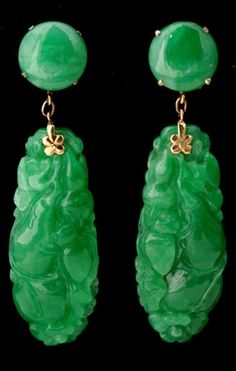 *JADEITE, 14K YELLOW GOLD PENDANT-EARRINGS. Each earring features an oval carved jadeite plaque suspended from a round jadeite cabochon completed by 14k yellow gold non-pierced screw back closures.  Circa 1930s.