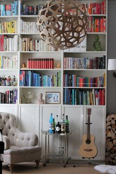 via thebowerbirds.com  Source: Apartment Therapy  Cosy and fun! That bookcase totally makes this room :)