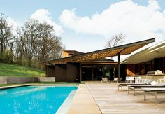 A dramatic trellis adds bravado and a passive cooling element to a recently renovated mid-century ranch house.