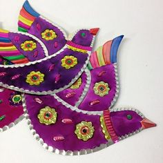 These are beautiful, large, cut tin birds that are painted bright colors like pink and purple. Excellent for adding a bit of shine to a wall or hanging from the ceiling or window. We use them to decorate during the holidays, fiestas and for Cinco de Mayo. They are very