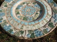 bird bath? - broken china & tile mosaic, via Flickr.
