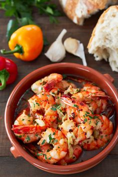With plump juicy shrimp cooked with loads of garlic browned in olive oil, Gambas al Ajillo (garlic shrimp) is an easy Spanish tapa that comes together in about five minute. Be sure to have some bread handy to sop up the delicious briny oil. Prawn Recipes, Seafood Recipes, Cooking Recipes, Healthy Recipes, Garlic Shrimp Recipes, Spanish Food Recipes, Authentic Spanish Recipes, Cooking Rice, German Recipes