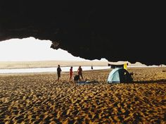 People on Beach by Blue Tent