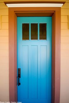 This cerulean blue is like a breath of fresh, energetic air against the orange hues of this home's exterior.