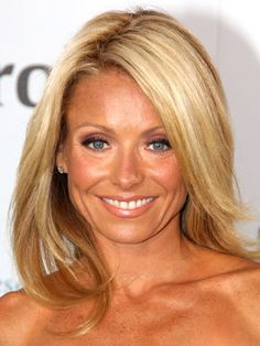 """To achieve Kelly Ripa's look, blow-dry your hair with Paul Labrecque Repair Style Hydrating Hair Lotion and a medium thermal brush. """"This will create a smoother, shinier result,"""" says New York celebrity stylist Paul Labrecque. Smooth the ends and add a finishing polish to seal in moisture."""