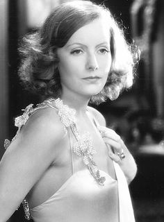 Greta Garbo, 1928.   I love the dress, too: Simple and sexy. (Sorry, we just had prom season a few weeks ago, and all the stores had windows and displays of over-done, overly complicated prom dresses. This is a refreshing change!) --Ron
