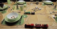 Awesome! This dinner table is made of tiles. Versatile tiles - with tracks on one side for a train to maneuver aroun