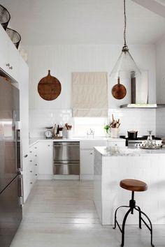White subway tiles, stainless steel appliances, clean kitchen