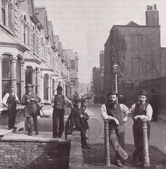 Builders on a break at Clapton Passage, Hackney c.1882.