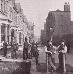 Builders on a break at Clapton Passage, Hackney c.1882.
