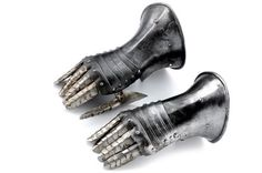 A pair of composite gauntlets dating: early 17th Century provenance: Europe Cuffs ribbed at the back, with roped margins, one twisted; five-...