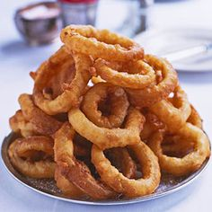 Set out a plate of these crispy appetizers and watch them disappear. The beer batter nicely coats the onion and fries to a lovely shade of golden brown.