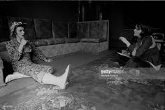 Singer David Bowie (1947 - 2016) being interviewed at his ground floor flat at Haddon Hall, where he has been redecorating the ceiling in silver paint, Beckenham, London, 24th April 1972.
