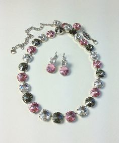 A Very Feminine Necklace Handmade With 29 Genuine 12mm Swarovski Crystals. This necklace encircles the whole neckline. Absolutely Stunning Statement