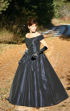 $179.95 This classic taffeta gown has fitted and boned bodice. The neckline is low scooped and the dress has a slight V-shape to the front and back waist. Short shirred sleeves are off-the shoulder. The skirt is very full and can accommodate a hoop underneath (as shown) or a crinoline. Available in sizes XS to XXXXL. Your choice of zipper or hook and eye closure. Comes in a variety of colors to your preference. Dry clean.