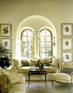love this window.  Beautiful living room with golden arched windows recessed in wall arch, gorgeous