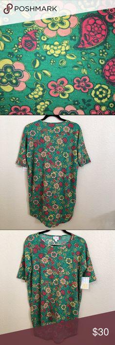 NWT LuLaRoe Irma Tunic Kelly green background. Fun floral print. Really pretty LuLaRoe Tops Tunics