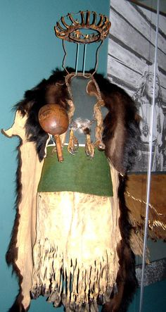 Shaman grizzly claw headdress, bear skin cape, eagle talon necklace and cedar rattle National Museum of the American Indian