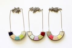 Days of August – The Color Wheel.  Reversible necklace made from reclaimed industrial stainless steel and cotton thread.  Colors on the front, stainless steel on the back. Perfect for engraving. • Available at thebigdesignmarket.com