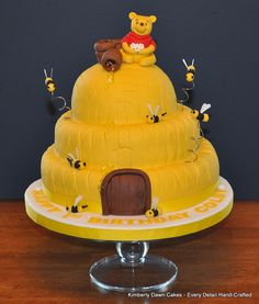 Winnie the Pooh Cakes, via Flickr- probably with a plastic figure and not pooh bear out of fondant