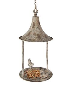 Invite feathered friends to your space and add an elegant rustic touch to your outdoor décor with this bird feeder that features a dazzling branch design.