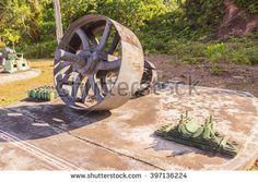 Phuket, Thailand - March 26, 2016: Big flywheel installed with crank shaft of big engine for tin mining works demonstrated at Phuket Mining Museum, Thailand - stock photo
