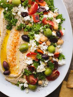 This Loaded Hummus is a great crowd-pleasing appetizer but the hummus recipe itself is a keeper Make this regularly and keep a container in the fridge It s great for snacking lunches and dinners Naturally vegan and gluten-free From tasteLUVnourish Vegetarian Recipes, Cooking Recipes, Healthy Recipes, Appetizer Recipes, Appetizers, Appetizer Ideas, Healthy Snacks, Healthy Eating, Game Day Food