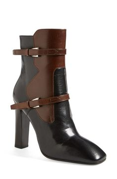 Two tone Prada boots for the wardrobe. In love with the double buckle detail.