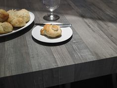 Formica® Laminate 6477 Seasoned Planked Elm makes for a stunning community table at this rustic restaurant. For Real.